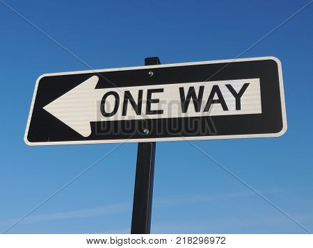 One way black and white traffic street sign