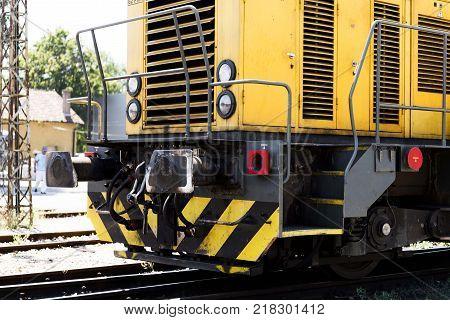 railway rail transportation. yellow locomotive on rails