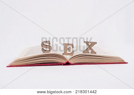 Word sex abstract letters, white background open book