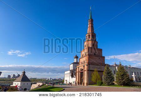 KAZAN, TATARSTAN, RUSSIA - MAY, 8 2016: Visitors walking along leaning Soyembika Tower (Khan's Mosque), the most familiar landmark and architectural symbol of Kazan.
