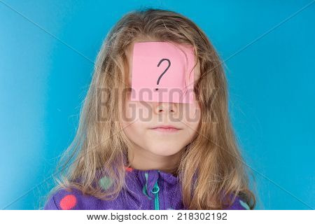 Girl and sticker question mark on forehead, Blue background
