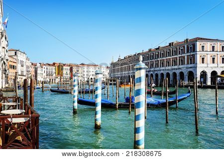 VENICE,ITALY- May 18, 2017 : Tourists on water street with Gondola in Venice. its entirety is listed as a World Heritage Site, along with its lagoon