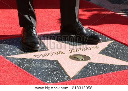 LOS ANGELES - DEC 13:  Dwayne Johnson Feet, Dwayne Johnson Star at the Dwayne Johnson Star Ceremony on the Hollywood Walk of Fame on December 13, 2017 in Los Angeles, CA