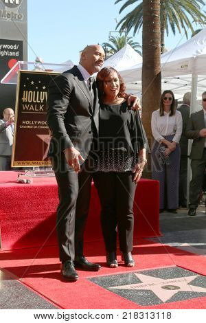 LOS ANGELES - DEC 13:  Dwayne Johnson, Ata Johnson at the Dwayne Johnson Star Ceremony on the Hollywood Walk of Fame on December 13, 2017 in Los Angeles, CA
