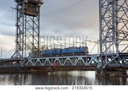 Train on the steel double-deck drawbridge over the Pregolya River in Kaliningrad (Konigsberg) Russia. The bridge was built in the 1913-1926 and was reconstructed in 1959-1965.