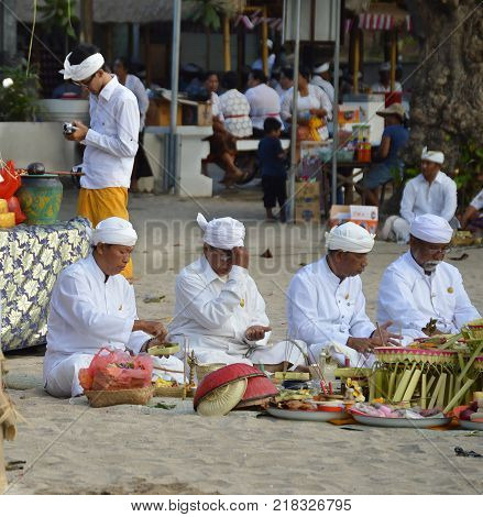 KUTA BEACH BALI INDONESIA - AUGUST 28 2015: Pemangku Priests at Religious Festival on a Sunny Summer Morning. Many Locals in attendance. Kuta Beach Bali August 2015