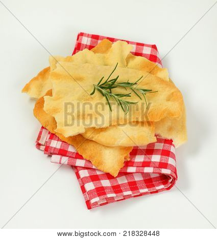 pieces of traditional Tuscan flatbread (Ghiottina Toscana) on checkered place mat poster