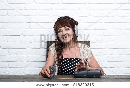 Old school music player radio. Audio book and new technology education. Spy and operator. happy granny dj in headset with cassette player. Old woman with cassette recorder listen music in headphones