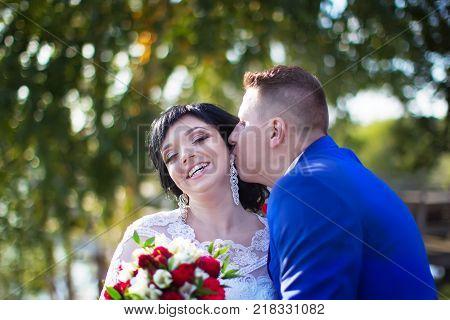 Belarus Gomel September 29 2017 Wedding Feast.The bridegroom is a kisser to the bride. Bride and groom. Happy bride and kissing groom