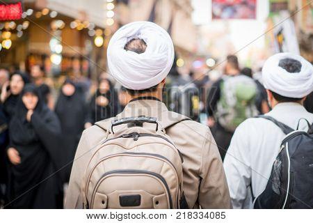 Pilgrims in Karbala walking towards The Holy Shrine of Imam Hussain