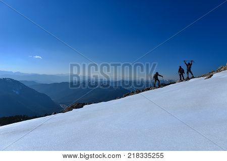 enormous and insurmountable mountain & mountaineering activities and success concept