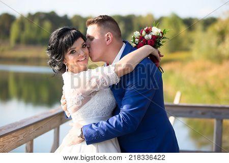 Belarus Gomel September 29 2017 Wedding Feast.The groom kisses the bride