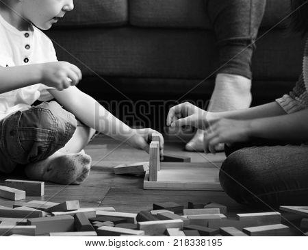 Children having fun playing toy blocks