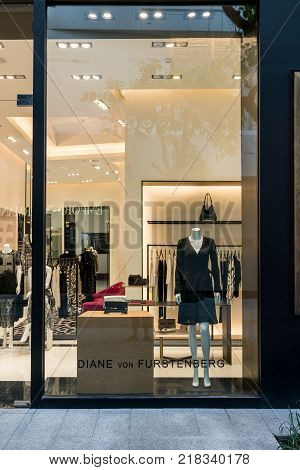 Diane Furstenberg shop at Emquatier, Bangkok, Thailand, Oct 15, 2017 : Luxury and fashionable brand window display. New collection of black clothings and clutch bag showcase at flagship store.