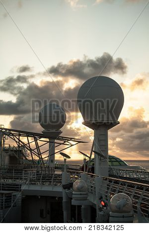 Ships Telecom Antenna at Dusk with cloud background