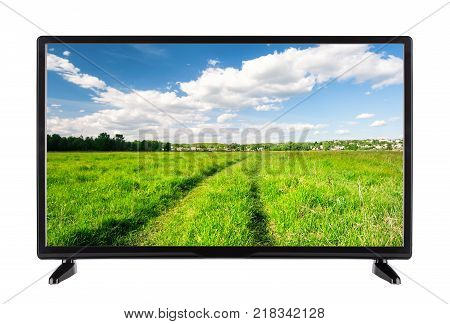 Flat high definition TV with a country road on the screen. Isolated on white.