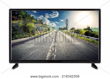 Flat high definition TV with mountain road on the screen. isolated on white background