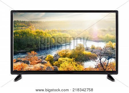 Modern flat-screen TV and autumn landscape with river on it. Isolated on white.