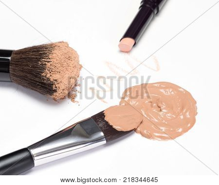Basic makeup products to create beautiful skin tone: concealer, foundation, cosmetic powder on white background