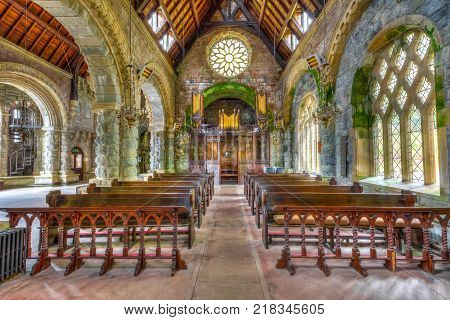 Argyll, Scotland, United Kingdom - June 1, 2015: central marble aisle of Saint Conan's Kirk gothic church nave with benches for prayers. Argyll town is in Scottish highlands.