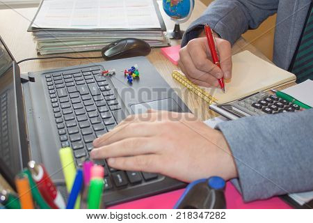 Businessman using a calculator to calculate the numbers. Accounting Accountancy Calculation Concept. Male using a tablet to analysis marketing. Businessman working at office desk