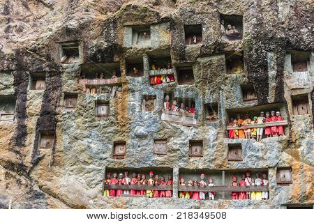Lemo Indonesia - september 5 2014: famous burial site with coffins placed in caves carved into the rock guarded by the statues of the dead persons (called tau tau in local language). Tana Toraja South Sulawesi
