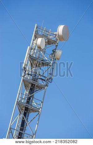 Paris France - September 3 2016: 4g phone network relay antenna with blue sky on background