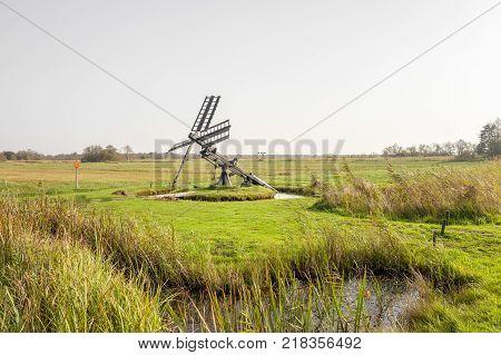 Paaltjasker windmill in Kalenberg in Friesland Netherlands.