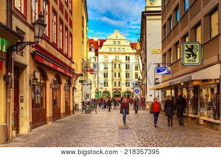 Munich, Germany - December 26, 2016: Downtown street view with people in Munich