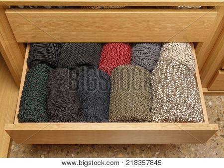 Top view of a well-organized closet drawer open with great storage system. Wardrobe order.