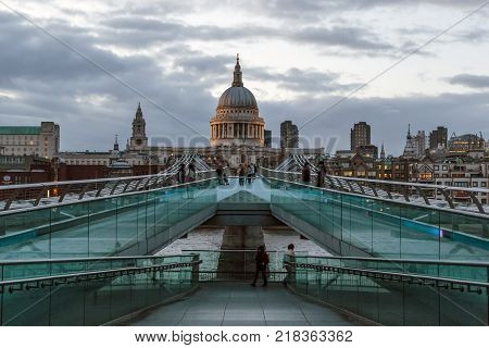 LONDON, GREAT BRITAIN - MAY 11, 2014: It is the London Millenium Footbridge of the Thames River Crosses in the area of St. Paul's Cathedral in the evening.
