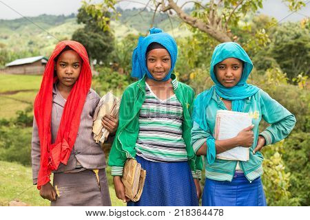 ADDIS ABABA, ETHIOPIA - MAY 4, 2015 : Young ethiopian schoolgirls holding their exercise books.