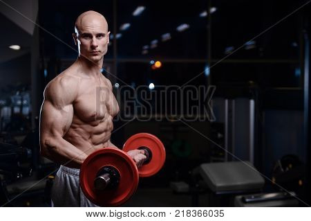 bald brutal sexy strong bodybuilder athletic fitness man pumping up abs muscles workout bodybuilding concept background - muscular handsome men doing health care fitness exercises in gym naked torso