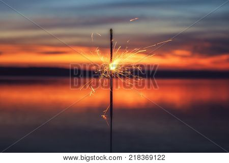 2018 Written With Sparkle Firework On Sunset Background, Happy New Year 2018 Concept