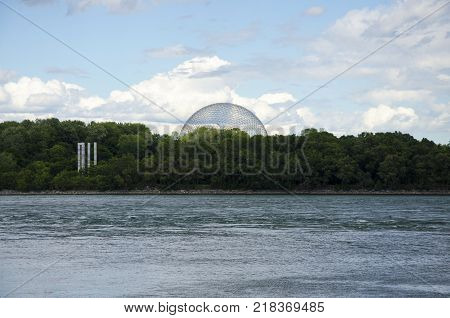 Montreal Quebec Canada - 17 July 2016: The Biosphere view from the river. The Biosphere is a museum in Montreal dedicated to the environment. Located at Parc Jean-Drapeau in the former pavilion of the United States as editorial