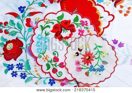Embroidery. Patchwork handwork embroidery closeup texture pattern studio photo background. Floral hungarian flower Embroidery.