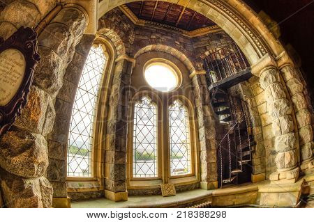 Argyll, Scotland, United Kingdom - June 1, 2015: circular arches of stained glass windows of Saint Conan's Kirk gothic church in Argyll town in Scottish Highlands.