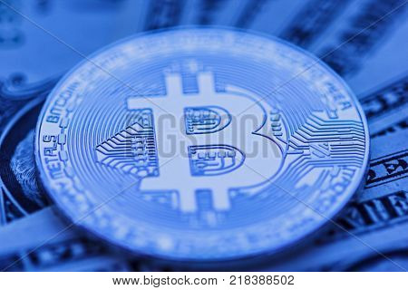 bitcoin close-up over dollar background
