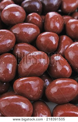 Dark and dairy chocolate balls. Chocolate drops as background texture pattern. Bon bons. Choco chocolate drops. Sweets.