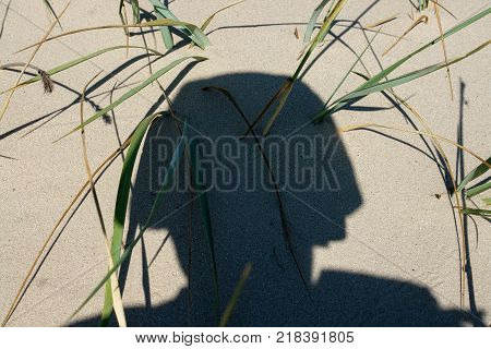 A shadow of a soldier in a combat military helmet. Post combat disorder combat stress reaction is a big problem for military veterans of combat conflicts.