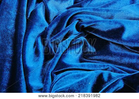 Blue velvet silk fabric wallpaper background. Velvet silk blue abstract art artsy cover closeup texture background. Blue.