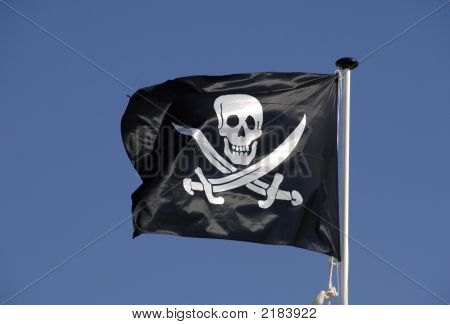 Pirate Flag Flying In Blue Sky