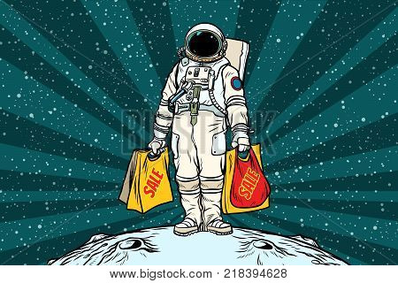 Lone retro astronaut with a sale shopping bags. Pop art retro vector illustration