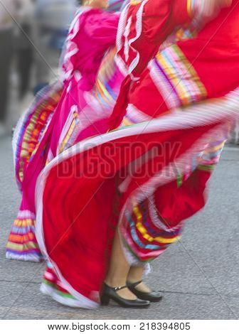 swirling red Mexican dance dress, street celebration