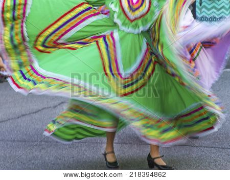 swirling colorful Mexican dance dresses, street celebration