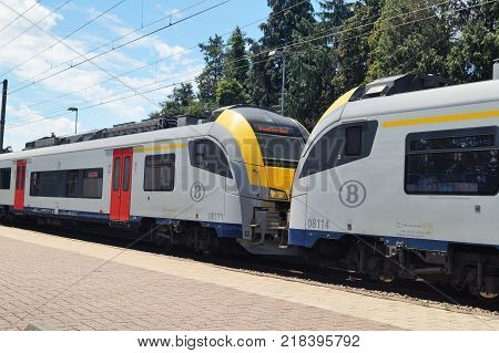 Waterloo, Belgium - June 11, 2017: A commuter train heading to Brussels at the Waterloo train station. Public transportation concept.