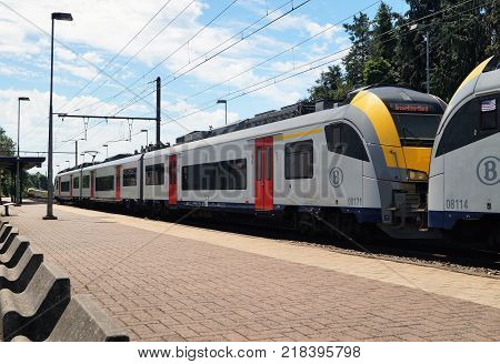 Waterloo, Belgium - June 11, 2017: A commuter train heading to Brussels at the Waterloo train station. Public transport concept.