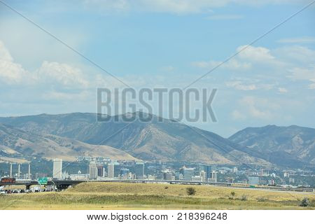 SALT LAKE CITY, UT - AUG 30: Downtown Salt Lake City in Utah, as seen on Aug 30, 2017. The city is bordered by the buoyant waters of the Great Salt Lake and the snow-capped peaks of the Wasatch Range.