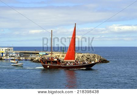 Torviscas harbour Tenerife Canary Islands Spain Europe - June 15 2016 : Tourists going on a sea tour on a sailboat
