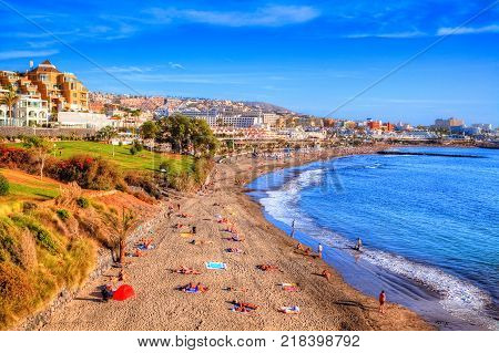Beautiful panorama with people on summer holiday in Fanabe beach, on the coast Adeje in Canary island, Tenerife - Spain